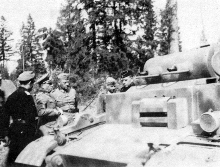 ​Inspection of the tanks that arrived at Mga. The man in a black uniform with his back to the photographer is Oberleutnant Betke, the commander of the 1st company of the 66th Special Purpose Tank Battalion - Pz.Kpfw.I Ausf. F: Pocket Tiger | Warspot.net