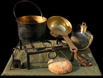 ​Kitchenware for cooking food while on the march: cooking grill for campfire, bronze pot for cooking a stew, bronze patera, canteen for water or wine. Furthermore there is oil lamp and bread baked in the ashes. Modern reenactment - Diet of Legionaries | Warspot.net