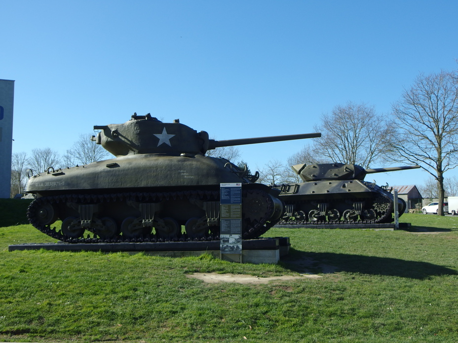 ​A Medium Tank M4A1(76)W and a GMC M10 outside of the Overlord Museum in Normandy. Both have 76 mm guns with similar ballistics, but their ammunition is incompatible - The Longest Millimeter | Warspot.net