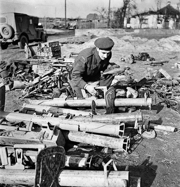 ​A Canadian soldier inspects Panzerschreck rocket launchers captured in Operation Blockbuster. Anti-tank rocket launchers were used by the Germans in large numbers - The Tank's Hidden Foe | Warspot.net