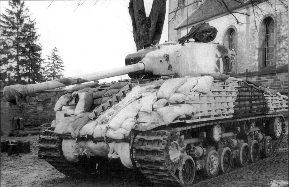 ​An M4A3(76)W HVSS tank with sand bag armour - The Tank's Hidden Foe | Warspot.net