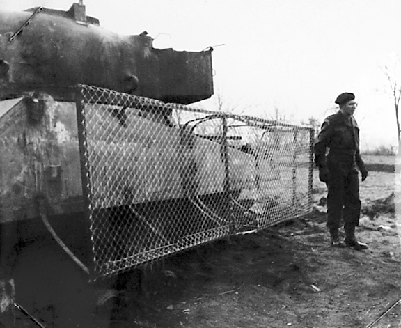 ​A mesh screen protecting the side of a Sherman tank during trials - The Tank's Hidden Foe | Warspot.net