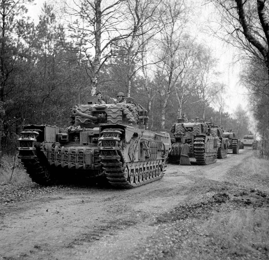 ​Churchill tanks from the 4th Coldstream Guards with Sherman tank tracks used as additional armour. This solution proved ineffective - The Tank's Hidden Foe | Warspot.net