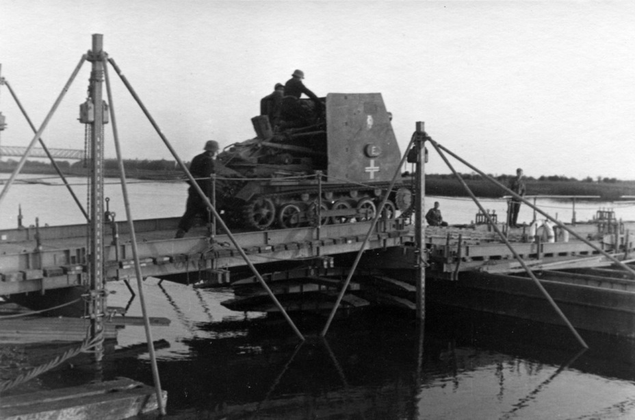 ​Fifth vehicle from one of the batteries, crossing a pontoon bridge, Eastern Front, summer of 1941 - Small, But Fierce | Warspot.net