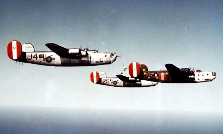 "​B-24H with serial number 41-28697 and nickname ""Spotted Ass Ape"" lead the bombers of the 458th Bombardment Group. It was this aircraft that at least once went all the way to the target and back. The front of the fuselage and the wings are painted white with red and blue polka dot, and the yellow and red dots are scattered over the tail which remained in the standard green-olive color. Red-white-red vertical plumage washers is a hallmark of the 458th BG. A toothy mouth is painted on the front - Highlights for Warspot: Judas goats and polka dot 