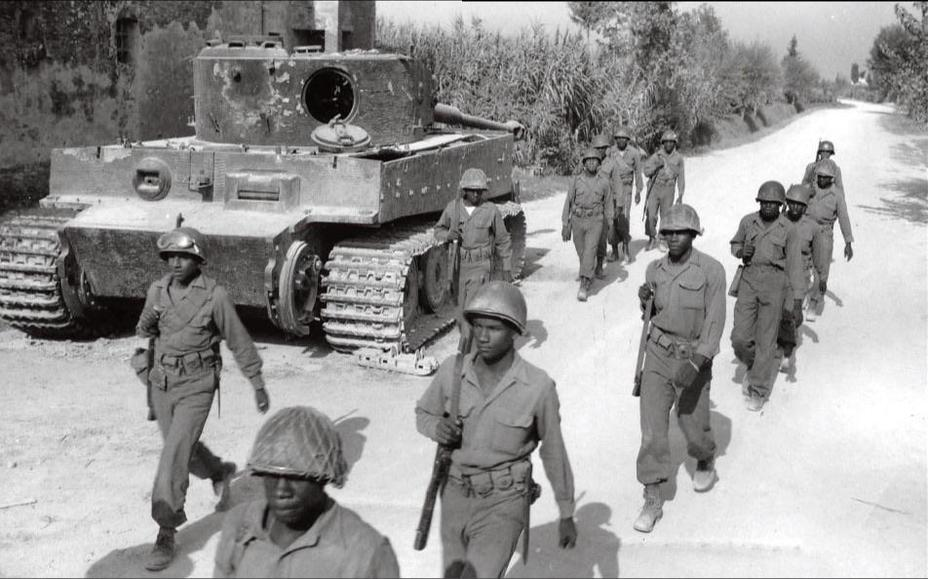 ​American troops in Italy marching past a disabled Tiger. The tank is short-tracked, indicating that the crew attempted to tow it after encountering final drive trouble, but was unable to do so - Tiger Killers | Warspot.net
