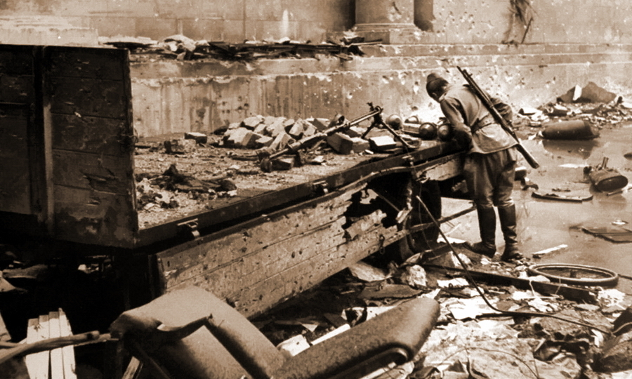 ​Red Army soldier looking at Faustpatrones that lie in a tipper in backyard of a Reich Chancellery in Berlin - «Panzerfäust almighty» | Warspot.net