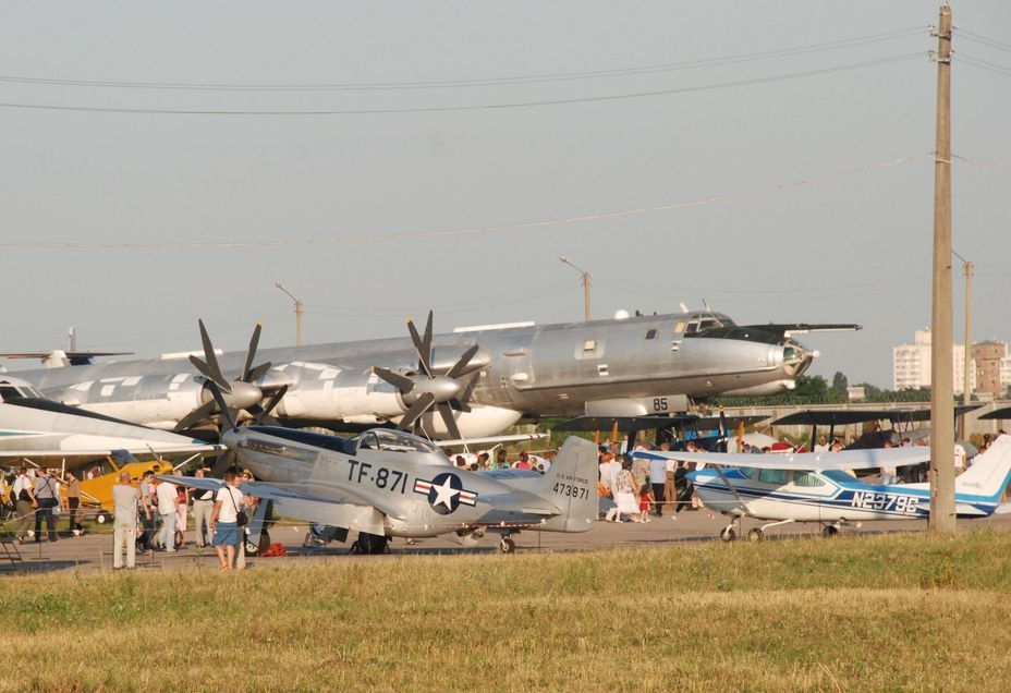 ​A huge anti-submarine aircraft Tu-142 and North American P-51 Mustang from a group of historic aircraft, that visited Kyiv under the leadership of British Prince Michael of Kent in 2013. Photo by the author - «Hidden» Aviation Museum | Warspot.net
