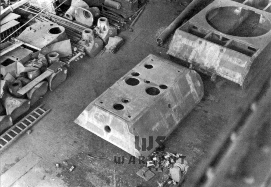 ​A Typ 205 hull and turret at a Krupp warehouse, 1945. Unneeded VK 36.01 turrets can be seen in the right corner - Stillborn Maus  | Warspot.net