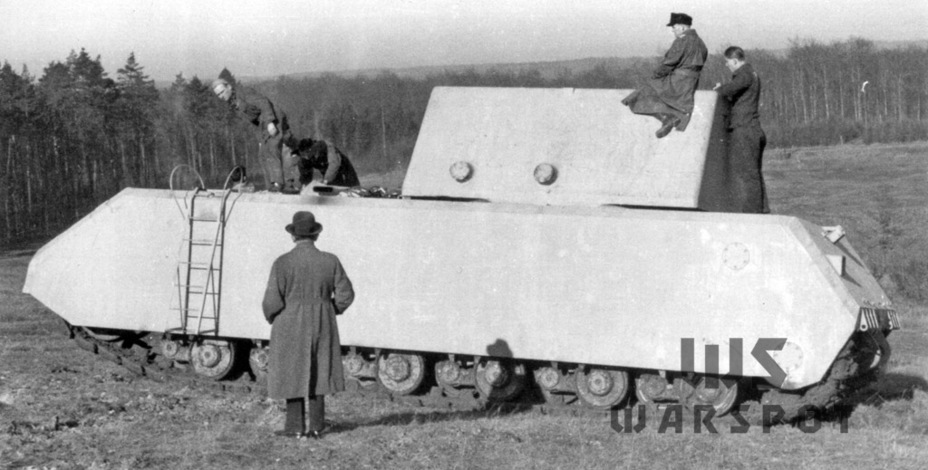 ​The first prototype on arrival at Böblingen. It is painted in the base coat. Ferdinand Porsche himself stands with his back to the camera in the center of the photo - Stillborn Maus  | Warspot.net